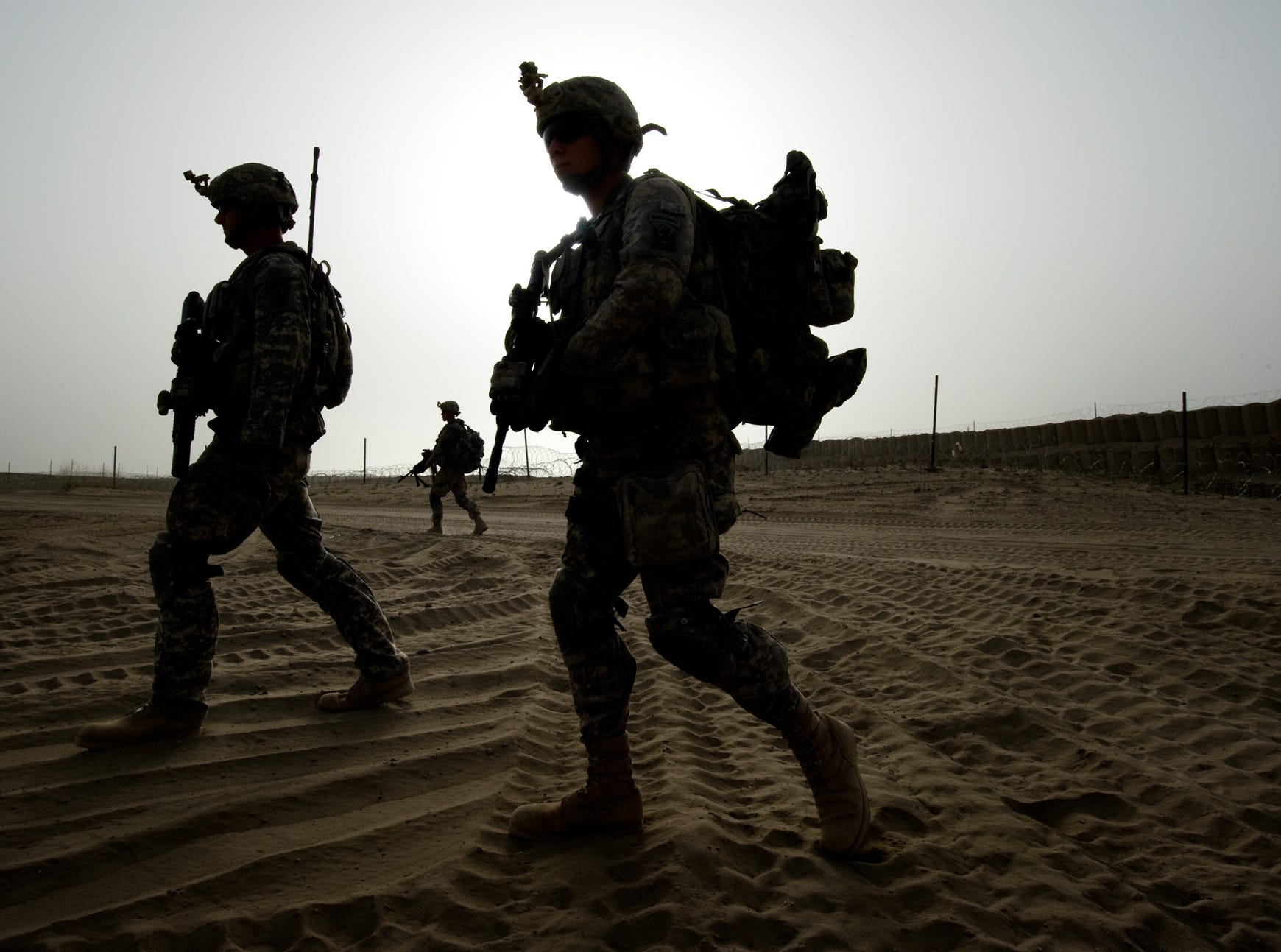 "Members of Vermont National Guard's Delta Company, 3rd Platoon, leave the safety of an Afghan Combat Outpost near the village of Rahman Keyhl in southern Paktia Province on Wednesday, September 15, 2010. The base, started two months ago, received repeated fire from insurgents in an area known to have a strong Taliban presence. Attacks have slowed with the presence of American, Afghan National Army and Macedonian soldiers, but areas nearby are still regarded as a ""Tier 1 Hot Spot"" by Delta Company."