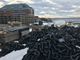 Heavy chain is stockpiled near the U.S. Coast Guard station in Burlington, in preparation for the assembly of a new marina's floating breakwater. Photographed on Tuesday, Feb 5, 2019.
