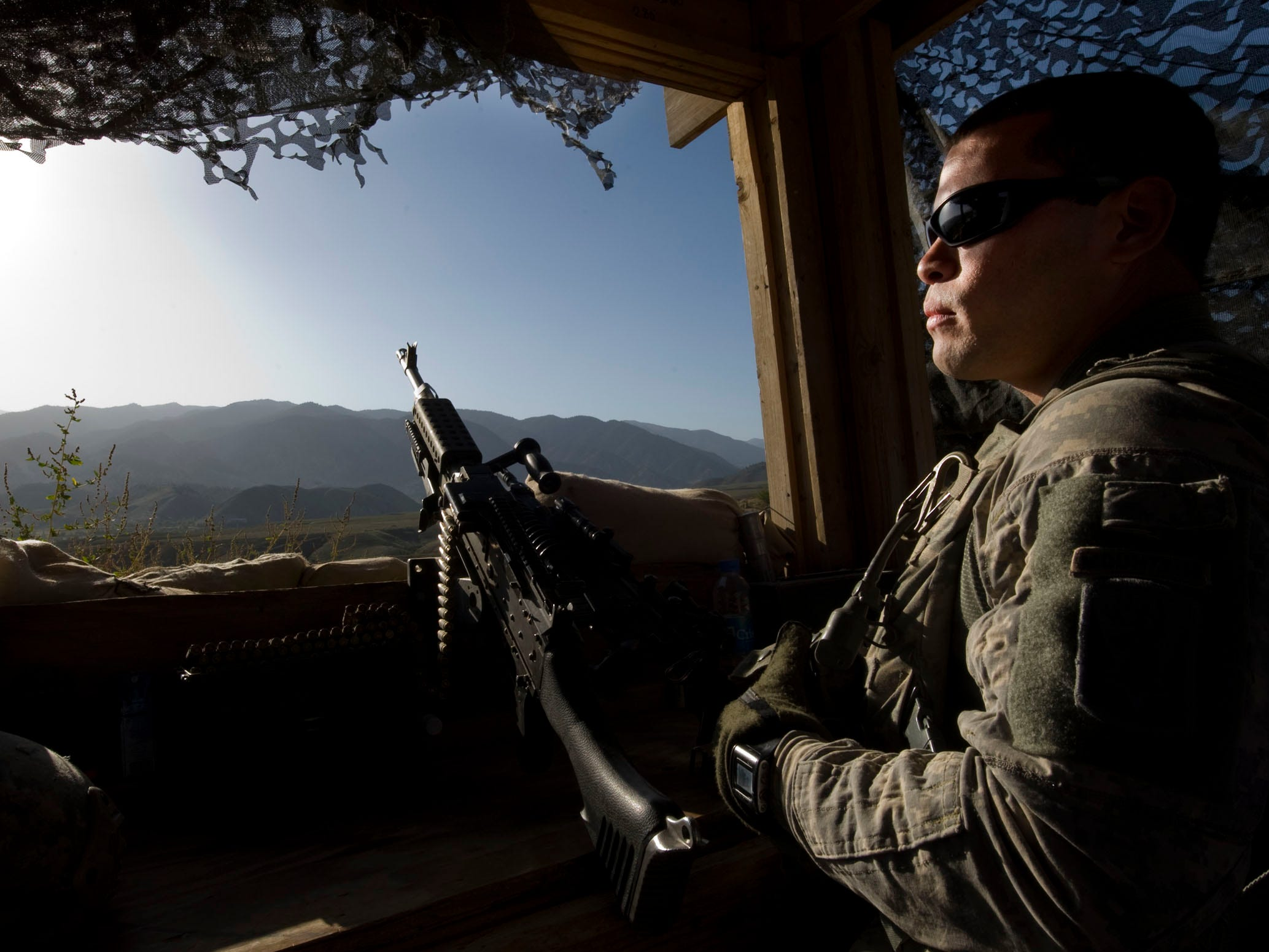 Vermont National Guardsman Spc. Edgar Velasquez of Burlington, Vt., looks out from a security tower at Combat Outpost Herrera in northeastern Paktia Province, Afghanistan on Monday, September 20, 2010. Vermont's Alpha Company, 3rd Battalion, 172nd Infantry (Mountain) is stationed at the remote outpost less than 8 miles from the Pakistan border.