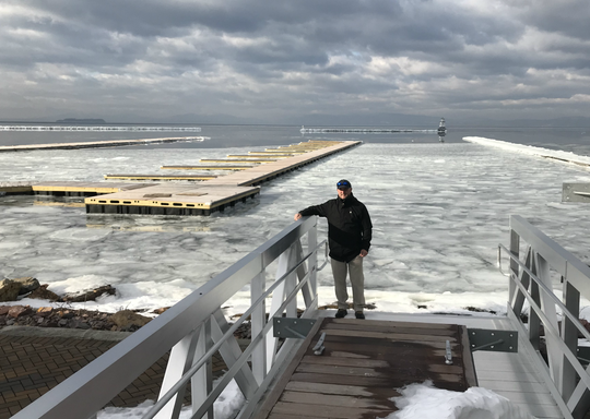 Jack Wallace, co-owner of the new Burlington Harbor Marina, stands at the end of a gangway that will service the facility when it opens in May. Photographed on Tuesday, Feb. 5, 2019.