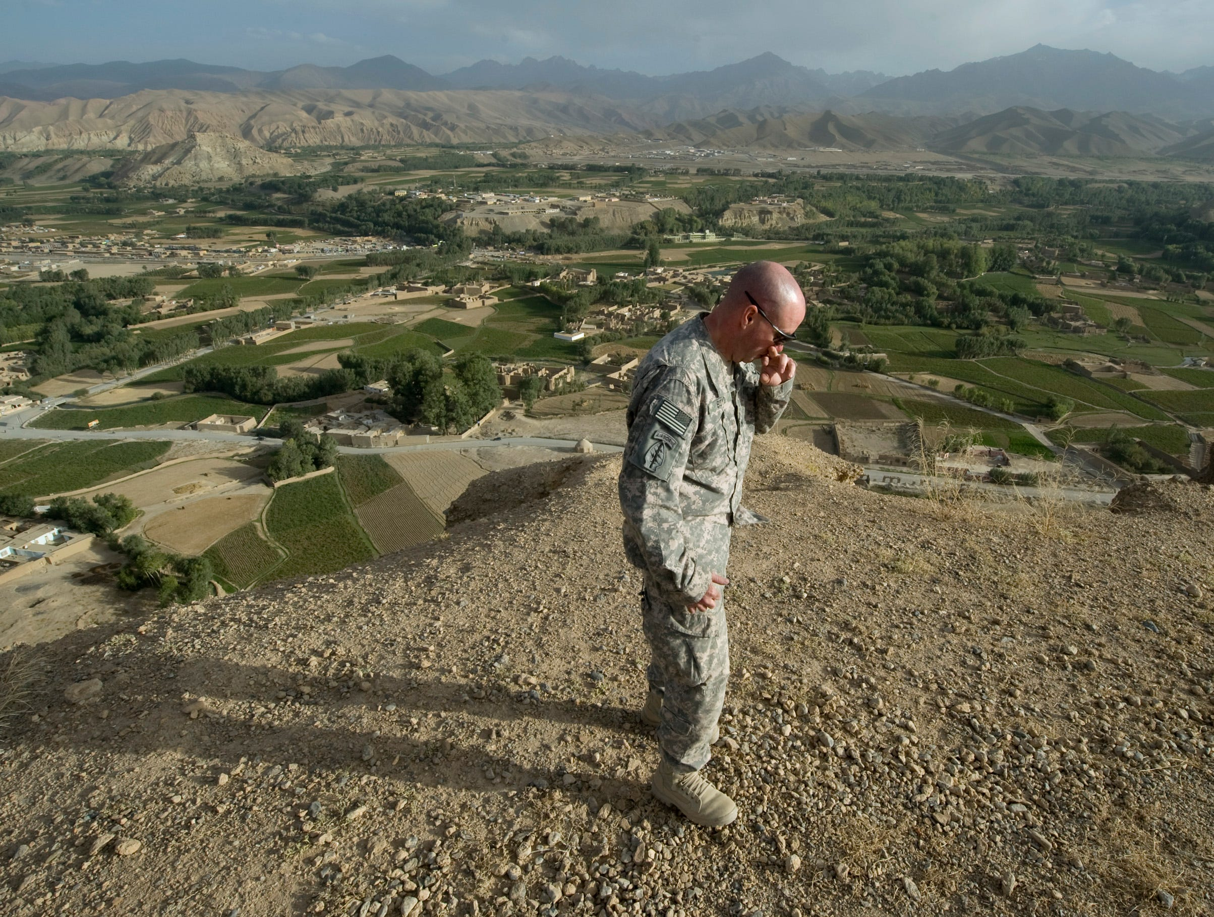 "September 2010: Col. John Boyd of Huntington, Vt., takes a moment of silence on top of what's known locally as the ""Male Buddha"" in Bamian City after spreading the ashes of a close family friend who died of leukemia back home. Col. Boyd offered to take the ashes to the most beautiful and special place he knows: a sacred cliffside where buddhist priests carved two massive statues into the rock. Years earlier, the Taliban came to the city and destroyed the statues, making residents watch and even help in the destruction."