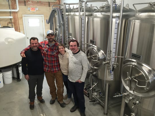From left to right, Collaborative Brewing Co. partners Craig Isvak, Steve Parker, Jen Fleckenstein and Brett Seymour stand among the Waitsfield brewery's tanks on Feb. 1, 2019.