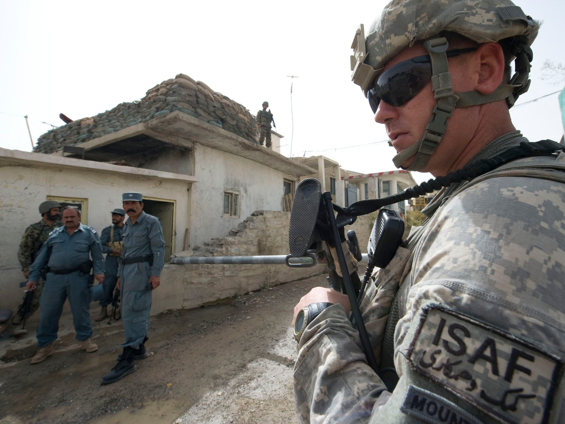 Vermont National Guard Sgt. Joseph Key of Charleston, W. Va., stands guard outside an Afghan Uniform Police check point in downtown Gardez City on election day, Saturday, September 18, 2010. A new police station on the north side of the city was attacked with mortar and rocket fire, but no injuries were reported.