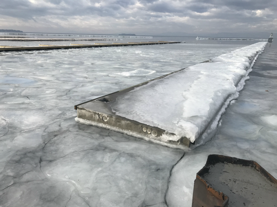 A section of floating concrete breakwater lies offshore near the U.S. Coast Guard station in Burlington — as part of a new marina scheduled to open in May. Photographed on Tuesday, Feb. 5, 2019.
