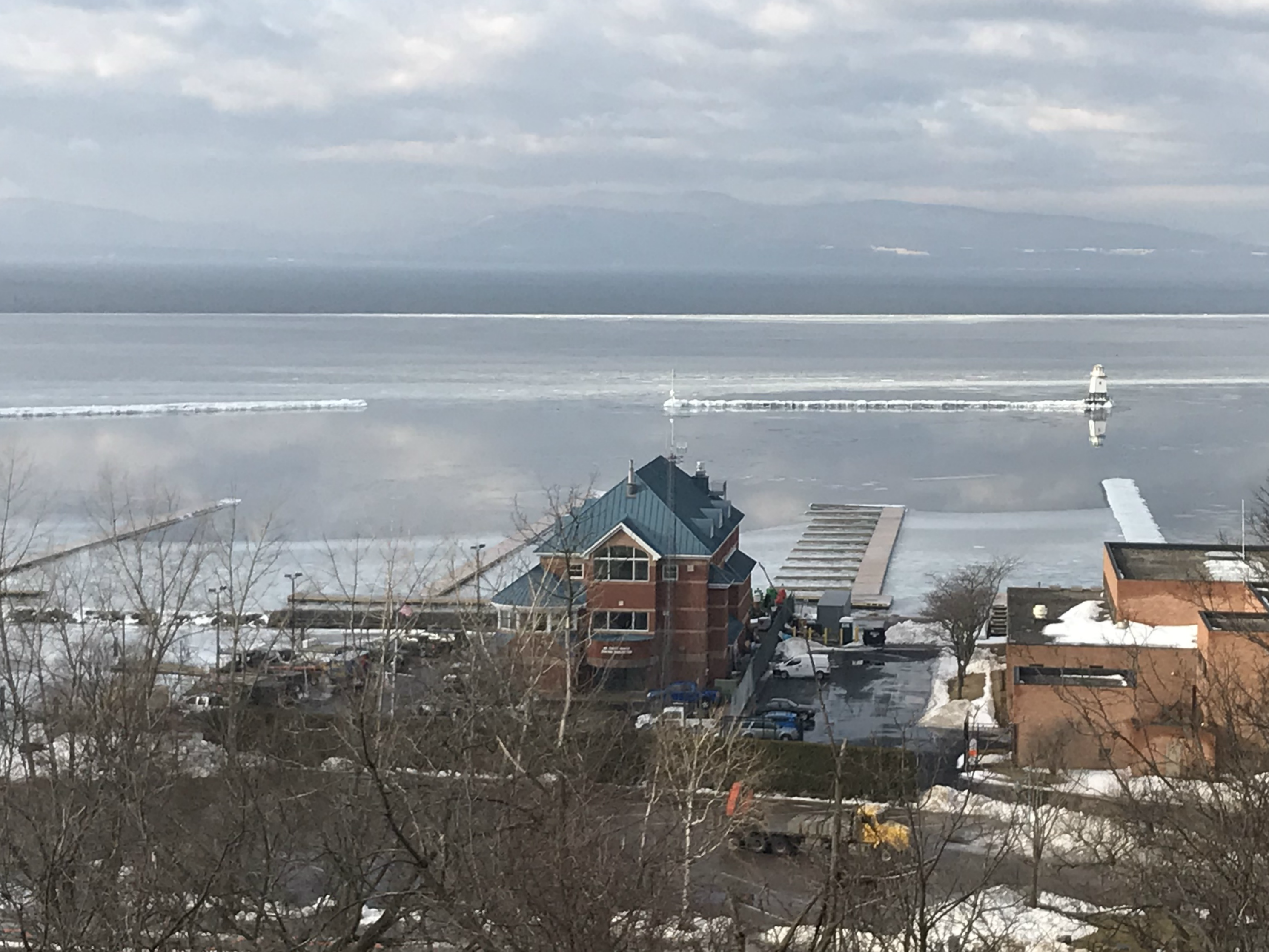 Portions of the new Burlington Harbor Marina lie offshore from the U.S. Coast Guard station on Tuesday, Feb. 5, 2019.