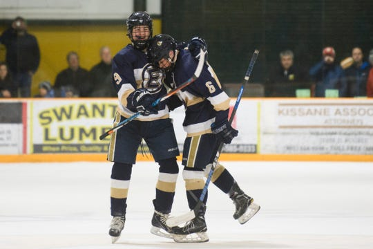 Essex's Joseph Maher (9) and Sam Gibbs (6) celebrate a goal during the boys hockey game between the Essex Hornets and the BFA St. Albans Bobwhites at the Collins Perley sports complex on Monday night February 4, 2019 in St. Albans, Vermont.