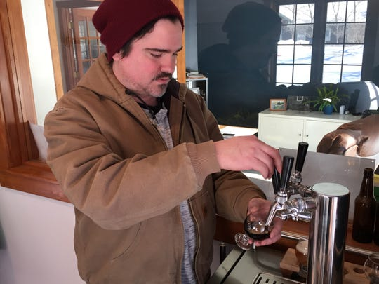 Brett Seymour, brewer at Collaborative Brewing Co., pours a beer in Waitsfield on Feb. 1, 2019.