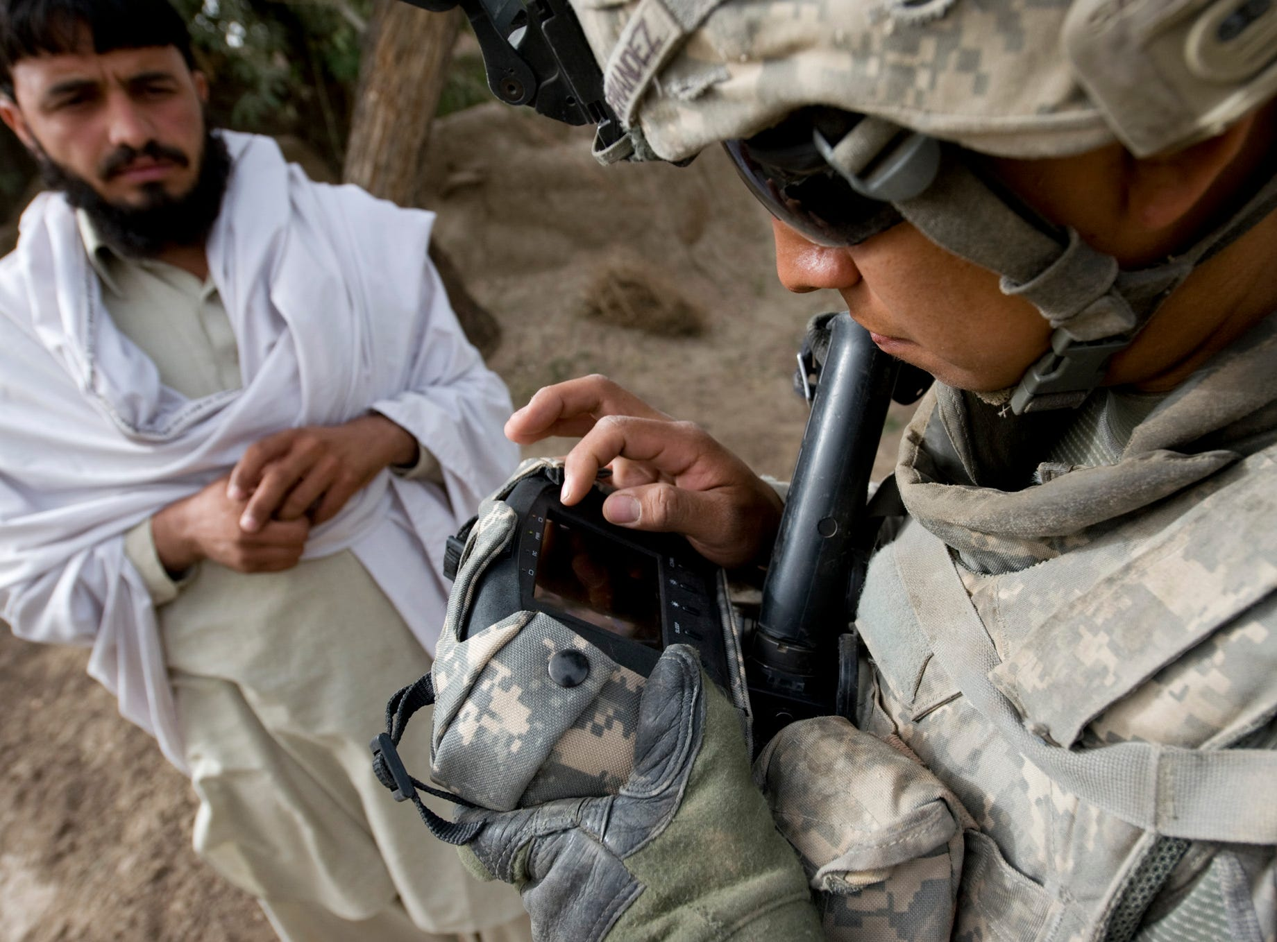 Vermont National Guard Sgt. Dennis Fernandez of Elkhart, Ind., of Delta Company, 3rd Platoon, enters in a Afghan man's name after taking his picture, a retinal scan, and finger prints with a HIIDE (Handheld Interagency Identity Detection Equipment) in a village in Rahman Keyhl in southern Paktia Province on Wednesday, September 15, 2010. The information is then stored in a national database to used to find known insurgents or, in a recent case, match fingerprints to those found on a IED.