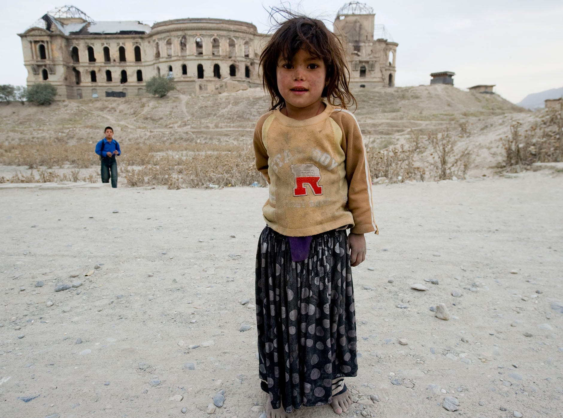 September 2010: A Kochis girl waits for a chance to beg money off passersby. Dozens of her people live in the ruins of the Afghan royal palace in Kabul which was heavily damaged in the civil war that ensued after the Soviets pulled out of the country in 1989.