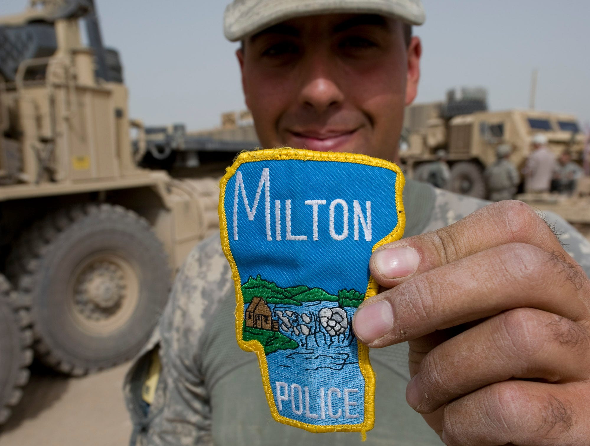 Vermont National Guardsman Sgt. Warren Burnor of Johnson, Vt., shows off his Milton Police patch after Echo Company arrived at a new Afghan Combat Post in Rahman Kheyl, a remote part of Afghanistan in southern Paktia Province, on Tuesday, September 14, 2010.