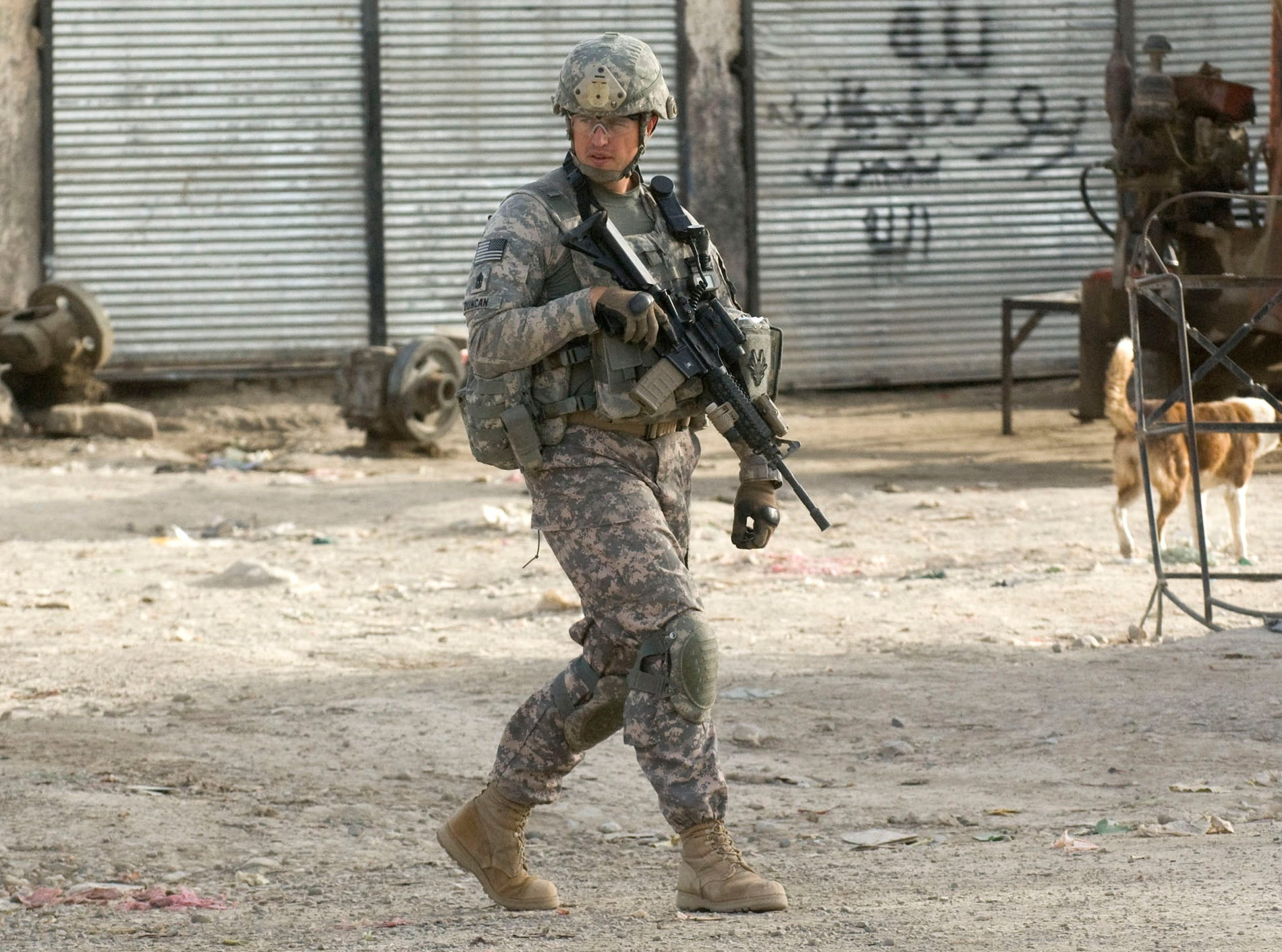 Vermont National Guard 1st Sgt. Eric Duncan of Northfield, Vt., checks on his fellow soldiers' positions as Delta Company conducts a raid on a suspected IED and weapons cache in downtown Gardez, Paktia Province, Afghanistan, on Friday morning, September 17, 2010. No weapons or bomb-making materials were found, but the raid was delayed hours after Afghan police failed to show up on time.