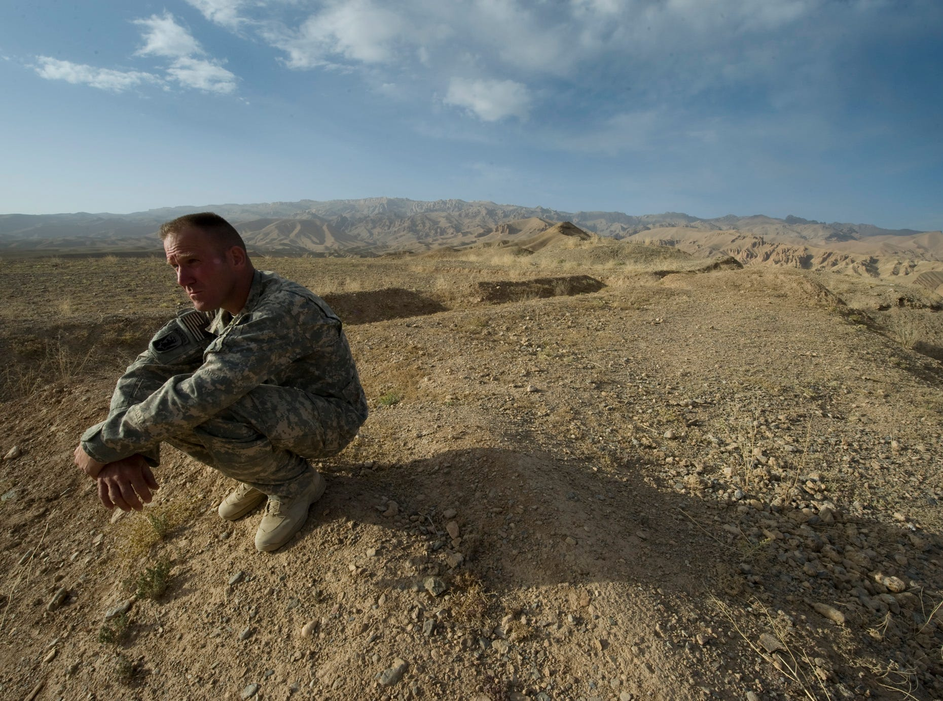 Vermont National Guard Sgt. Maj. Neil Roberts of Fairfax, Vt., sits on top of Band-e-Amir at the foot hills of the Hindu Kush Mountains in Bamian City in central Afghanistan on Friday, September 10, 2010. The surrounding area is littered with land mines left by the Russians when they occupied the area. A narrow goat path threading the mine field provides access to the top.