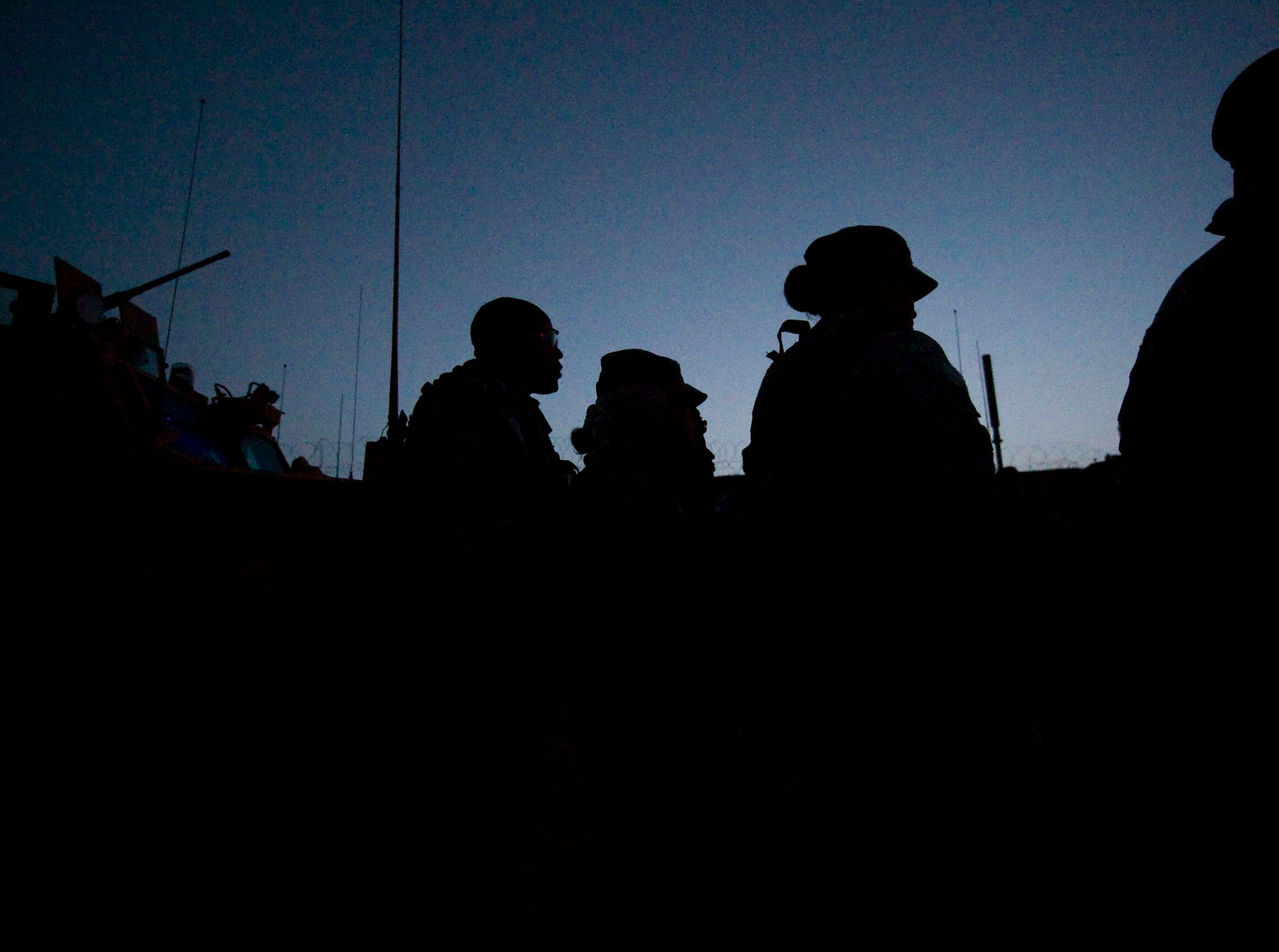 The 615th Military Police Company listens to a briefing by Capt. Bryan Anderson before a raid of a suspected weapons and IED cache early Friday morning, September 17, 2010, in Gardez in Paktia Province.
