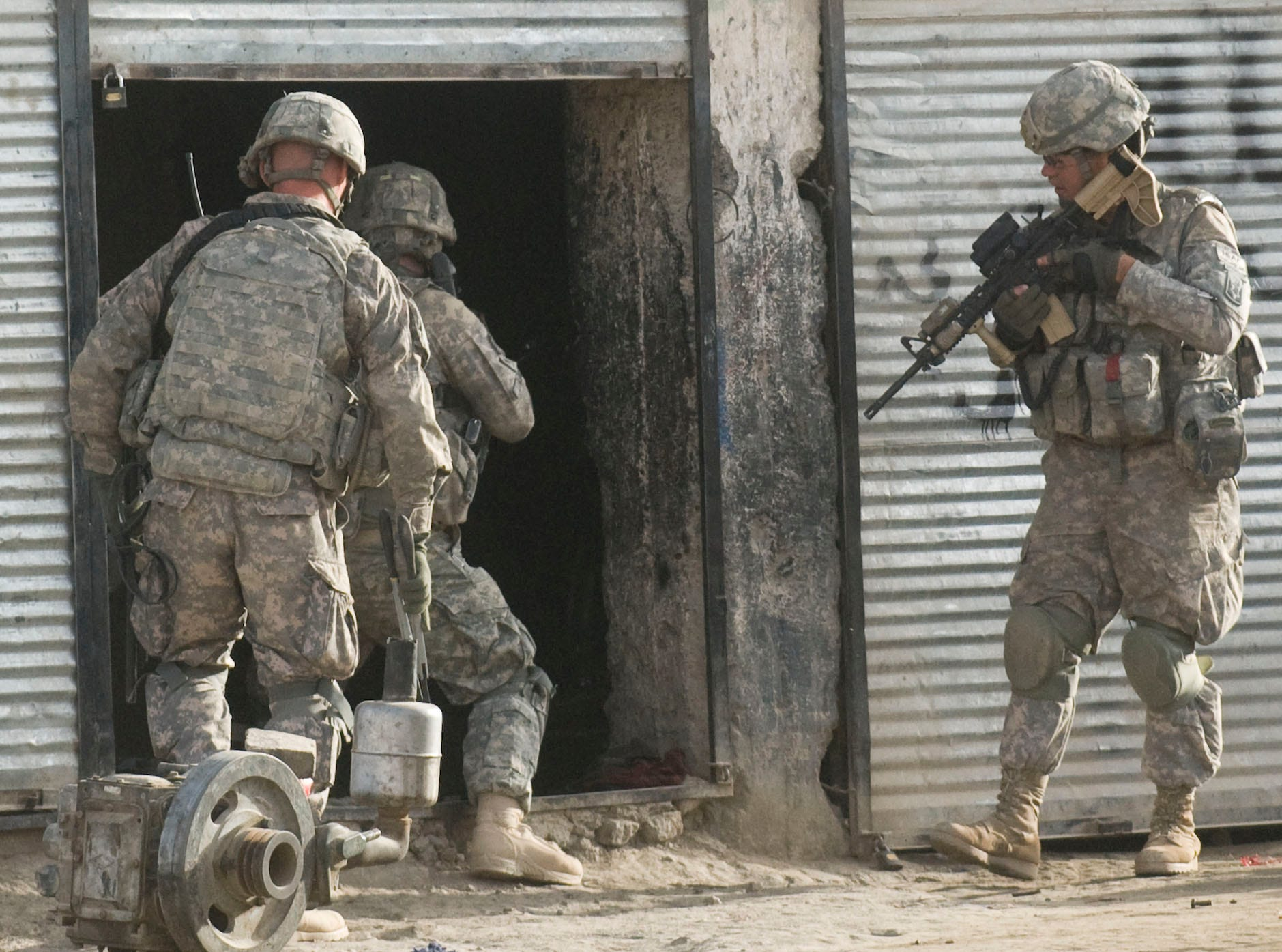 Right, Vermont National Guard Sgt. Donald Stocker of Bellows Falls, Vt., covers fellow soldiers entering a building in downtown Gardez in Paktia province, Afghanistan, Friday morning, September 17, 2010, looking for suspected IED and weapons caches. The early-morning raid was delayed several hours after local Afghan police failed to show up on time, leading some soldiers to question weather insurgents were tipped off before the raid.