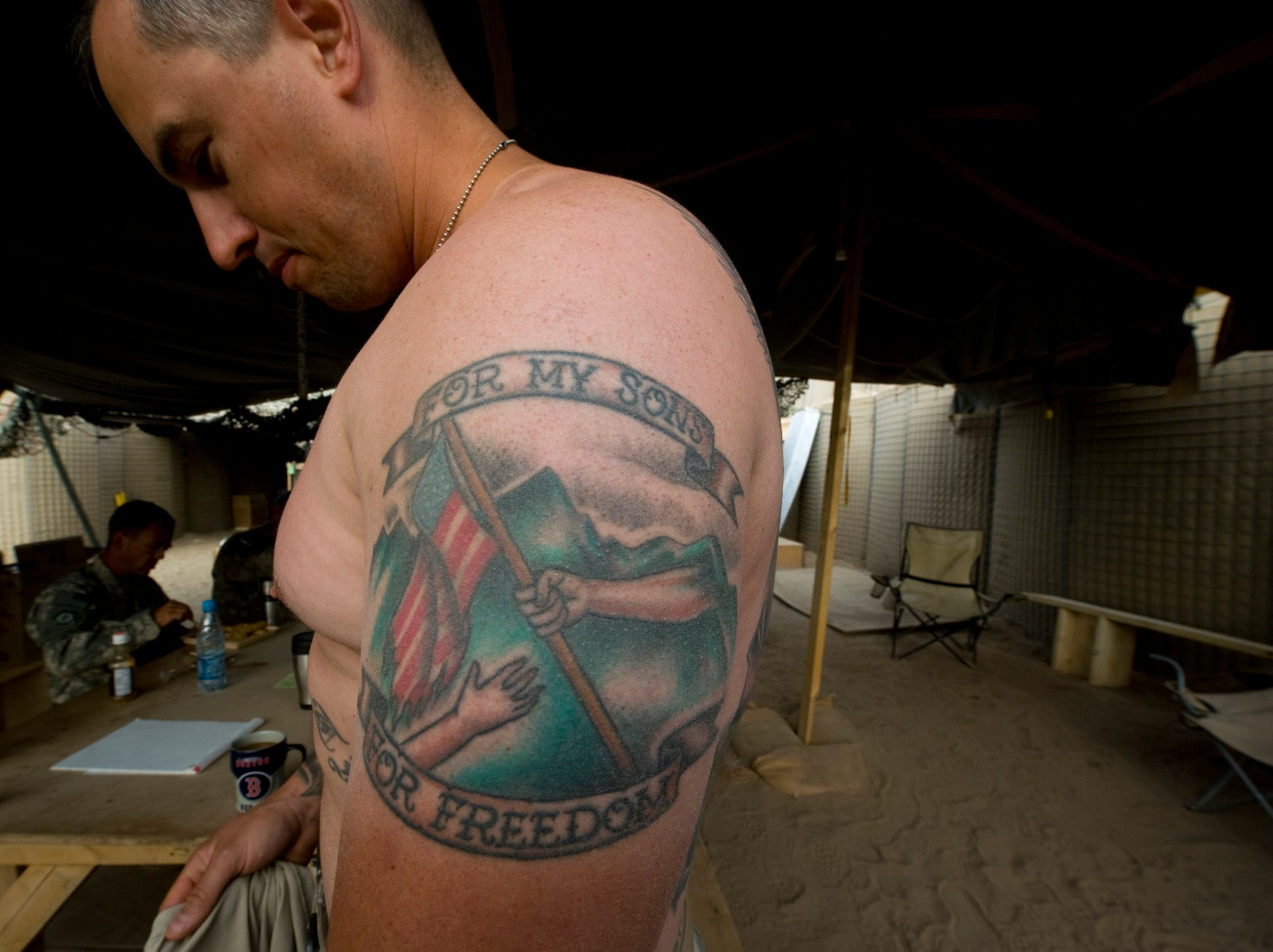 Vermont National Guard 1st Sgt. Eric Duncan of Northfield, Vt., displays tattoos expressing his fervor for serving at a new Afghan Combat Outpost in Rahman Keyhl in southern Paktia Province.