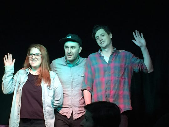 "Host Anthony Apodaca (center) stands with Jenna Emerson and Bryan Parmelee at Revelry Theater's ""Dubious Advice"" in Burlington on Feb. 2, 2019."