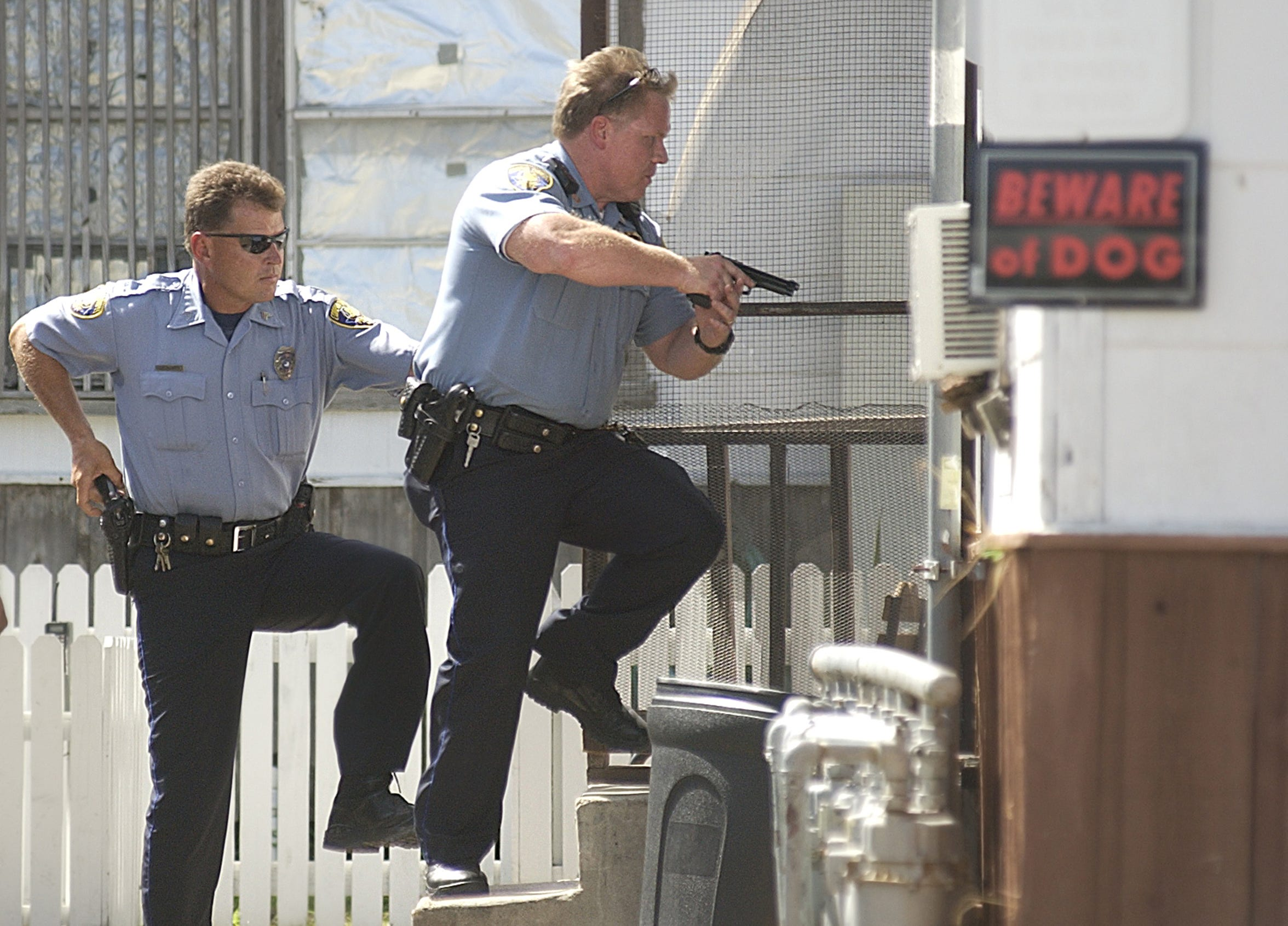 In this 2004 photo, Corpus Christi Police Officer Chris Hooper and Officer David Cook enter an apartment in the 1200 block of Barton St.