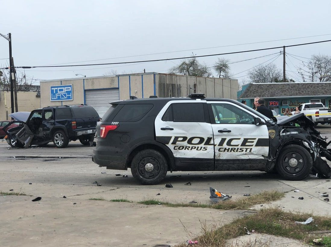 A Corpus Christi police patrol unit has heavy damage to its front end following an accident on Port Avenue the morning of Tuesday, Feb. 5, 2019. The unit struck a Chevrolet Tahoe, background, but details of the accident were not immediately released.