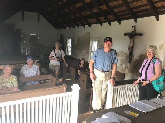 Hal and Sandra Totten, in the foreground, were among tourists visiting La Lomita Chapel in Mission, Texas, Feb. 5. 2019.