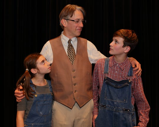 Atticus (Mike Doheny) teaches lessons of tolerance, dignity and courage to his children, Scout (Sophia Donato) and Jem (Michael Thompson) in 'To Kill a Mockingbird' by Mainstage Center for  the Arts.