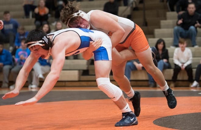 Cherokee's Zane Klinshaw takes down Williamstown's Matt Curran during the 170 lb. bout of the South Jersey Group 5 opening round tournament meet held at Cherokee High School on Monday, February 4, 2019.  Klinshaw defeated Curran 3-2, to clinch Cherokee's 32-39 playoff win over Williamstown.