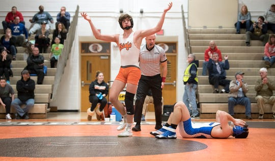 Cherokee's Nathan Lapinski celebrates after pinning Williamstown's Joseph Racobaldo to win the 160 lb. bout of the South Jersey Group 5 opening round tournament meet held at Cherokee High School on Monday, February 4, 2019.  Cherokee defeated Williamstown, 32-29.