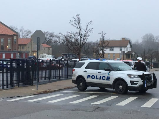 Police blocking off St. Williams Avenue in West Price Hill on Feb. 5 2019. Police SWAT team members are also staging in a parking lot as part of police activity.