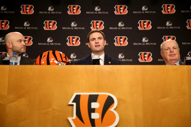 From left: Cincinnati Bengals director of player personnel Duke Tobin, new head coach Zac Taylor and team president Mike Brown speak at a press conference, naming Taylor as the 10th head coach in Cincinnati Bengals team history, Tuesday, Feb. 5, 2019, at Paul Brown Stadium in Cincinnati.