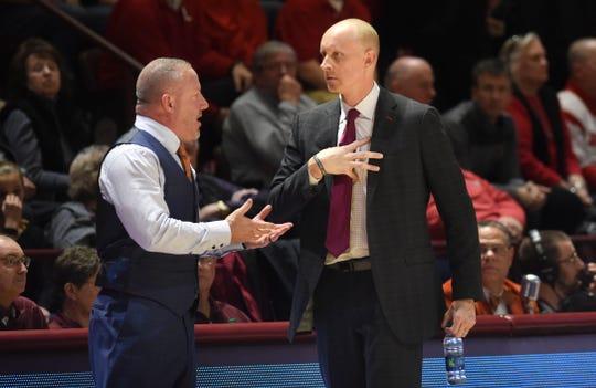 Virginia Tech Hokies head coach Buzz Williams and Louisville Cardinals head coach Chris Mack speak during the first half at Cassell Coliseum on Feb. 4.