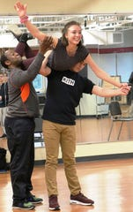 "Choreographer Jay Goodlett works on choreography with students Audrey Bristol, and Will Warfel for the IHHS Feb. 21-23  production of ""Mamma Mia"