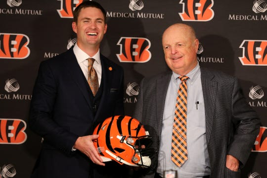 Zac Taylor, left, and Cincinnati Bengals president Mike Brown, right, pose for a photo after Taylor was named the 10th head coach in Cincinnati Bengals team history, Tuesday, Feb. 5, 2019, at Paul Brown Stadium in Cincinnati.