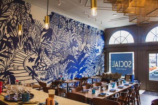 Interior of Social OTR restaurant, showing communal tables in dining room