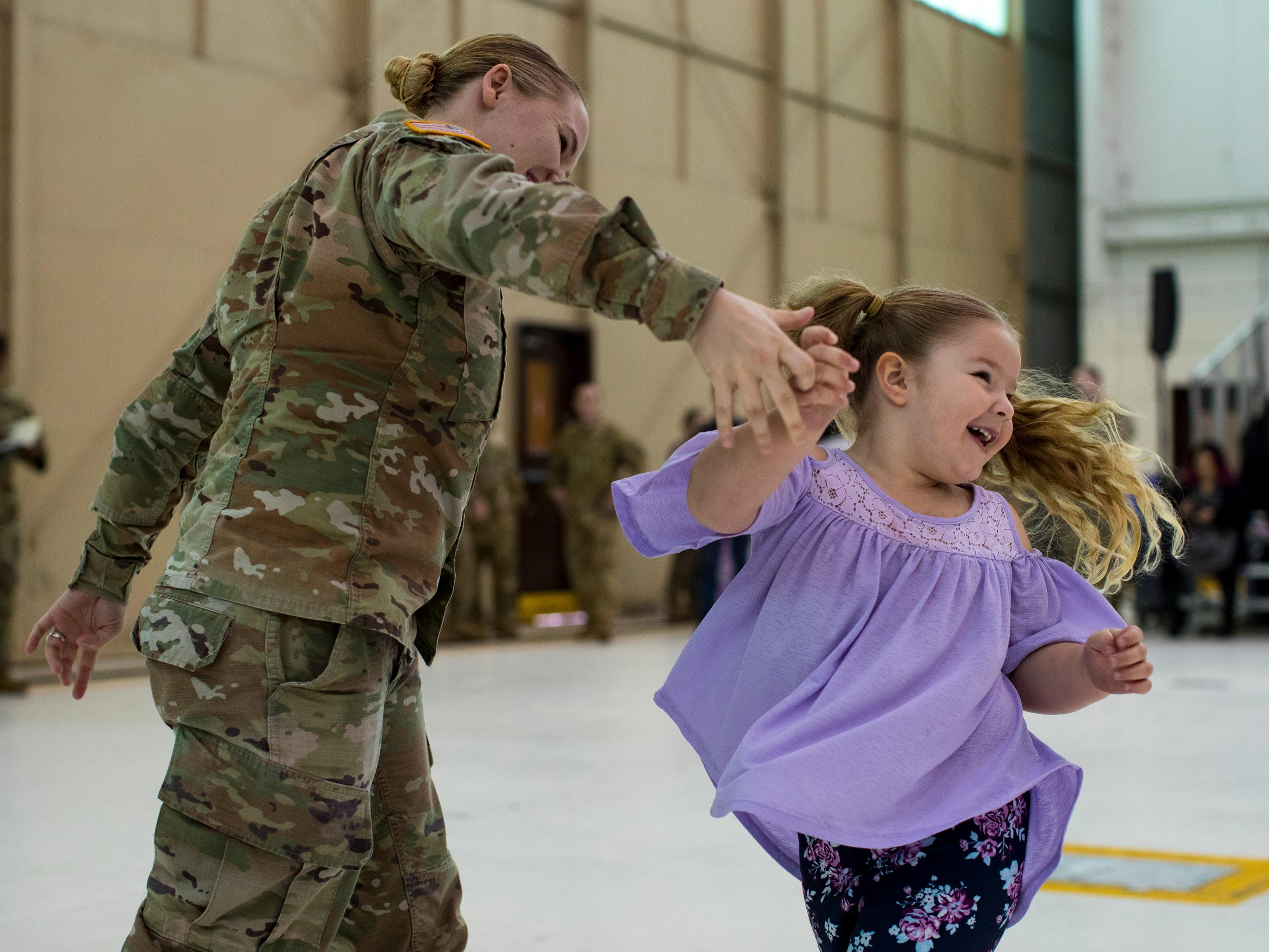 Dylann Letzelter, 4, dances as Sgt. Megan Campbell spins her around during the welcome home ceremony for members of the 101st Combat Aviation Brigade at Fort Campbell in Clarksville on Tuesday, Feb. 5, 2019. The soldiers were returning from a nine-month deployment to Afghanistan.