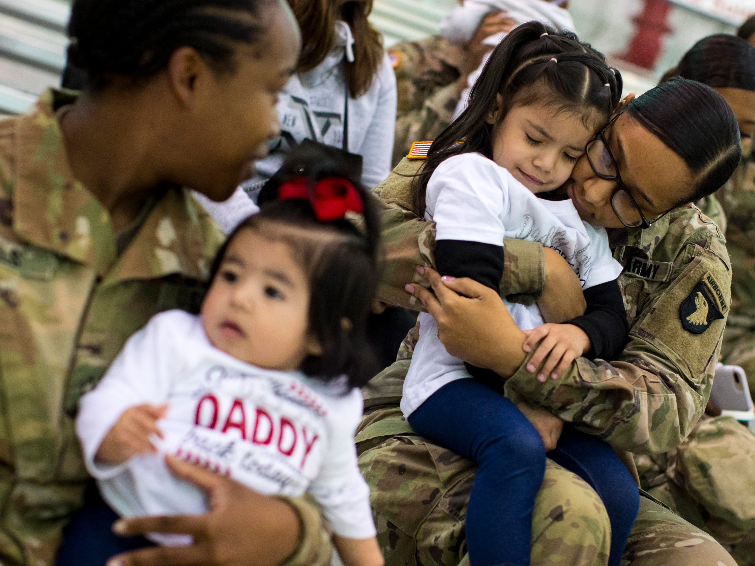 Private First Class Laura Davis holds Aliyah Barajas, 3, as Private First Class Taneka Daniels holds Eliana Barajas, 8 months, during the welcome home ceremony for members of the 101st Combat Aviation Brigade at Fort Campbell in Clarksville on Tuesday, Feb. 5, 2019. The soldiers were returning from a nine-month deployment to Afghanistan.