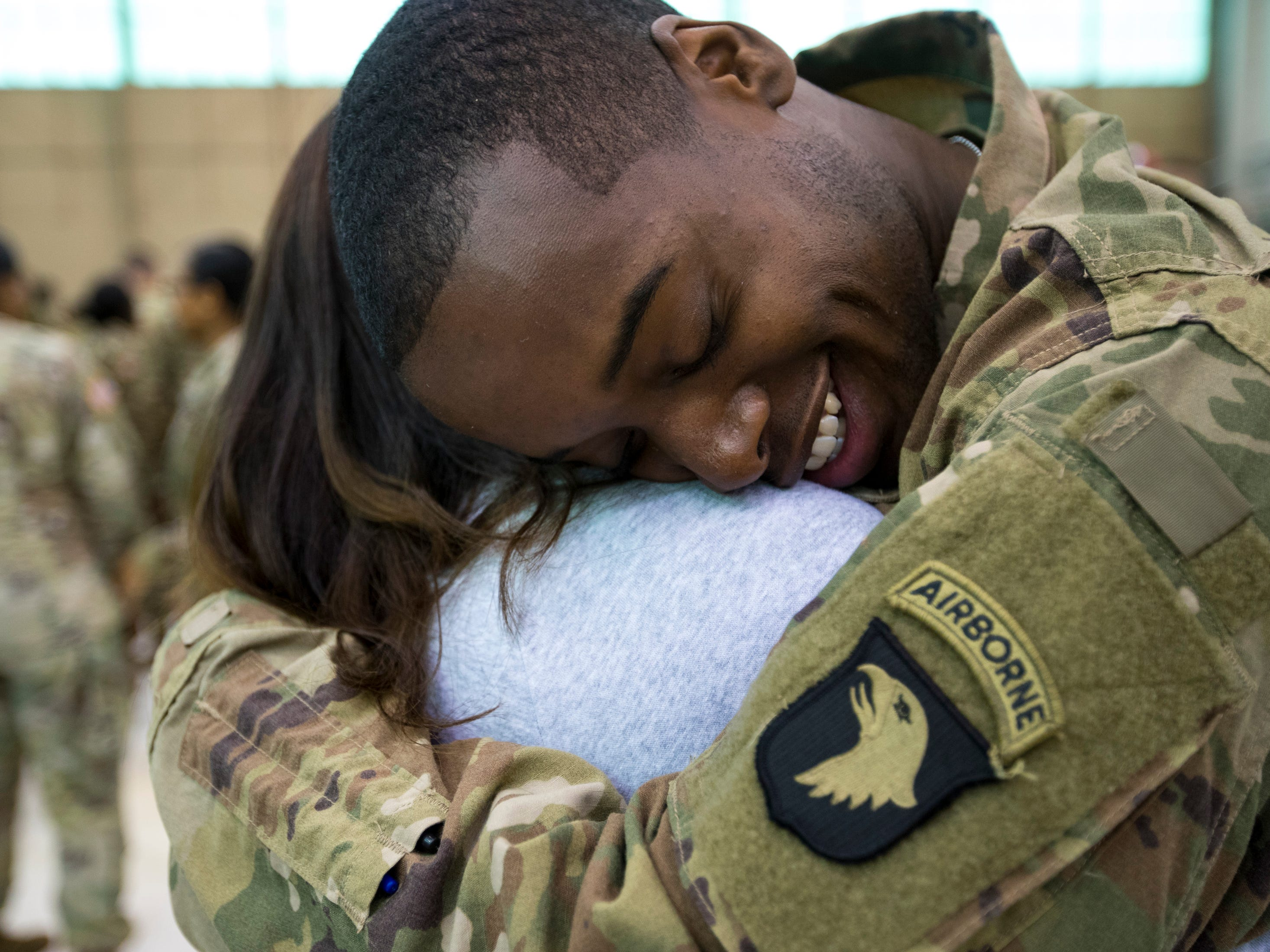 Specialist Kenneth King hugs his girlfriend, Specialist Christel Paloma during the welcome home ceremony for members of the 101st Combat Aviation Brigade at Fort Campbell in Clarksville on Tuesday, Feb. 5, 2019. The soldiers were returning from a nine-month deployment to Afghanistan.