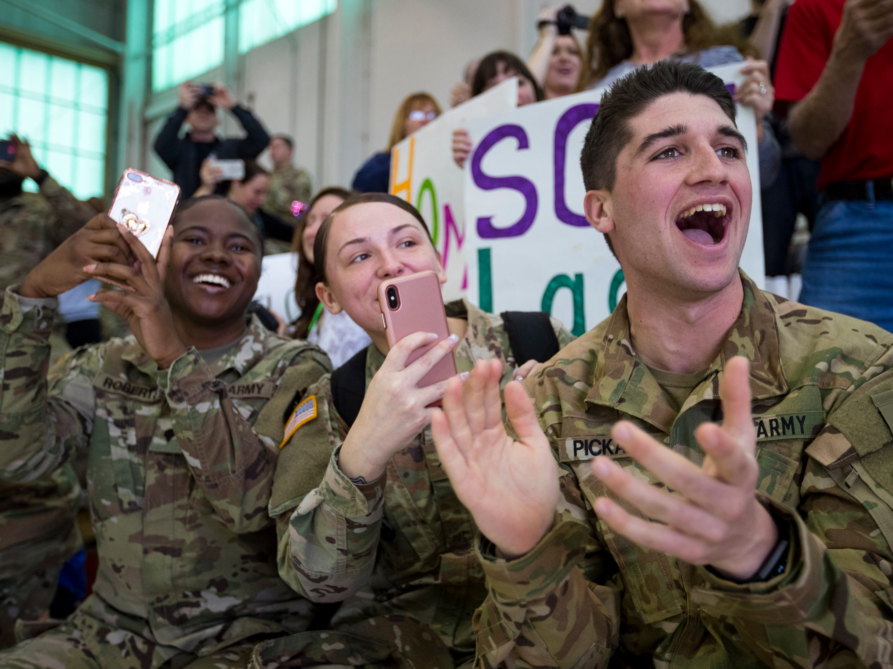 Specialist Ethan Pickard cheers as members of the 101st Combat Aviation Brigade enter a welcome home ceremony at Fort Campbell in Clarksville on Tuesday, Feb. 5, 2019. The soldiers were returning from a nine-month deployment to Afghanistan.