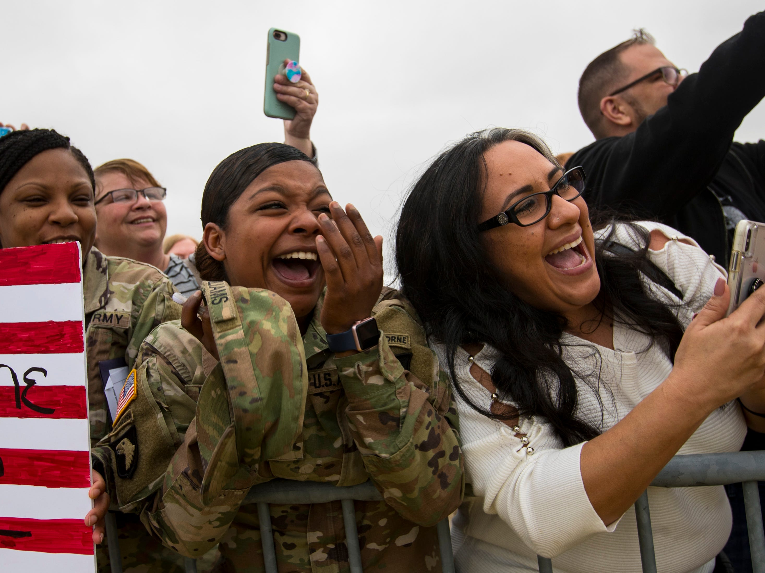 Private First Class Danielle Williams reacts to seeing a friend deplane during the welcome home ceremony for members of the 101st Combat Aviation Brigade at Fort Campbell in Clarksville on Tuesday, Feb. 5, 2019. The soldiers were returning from a nine-month deployment to Afghanistan.