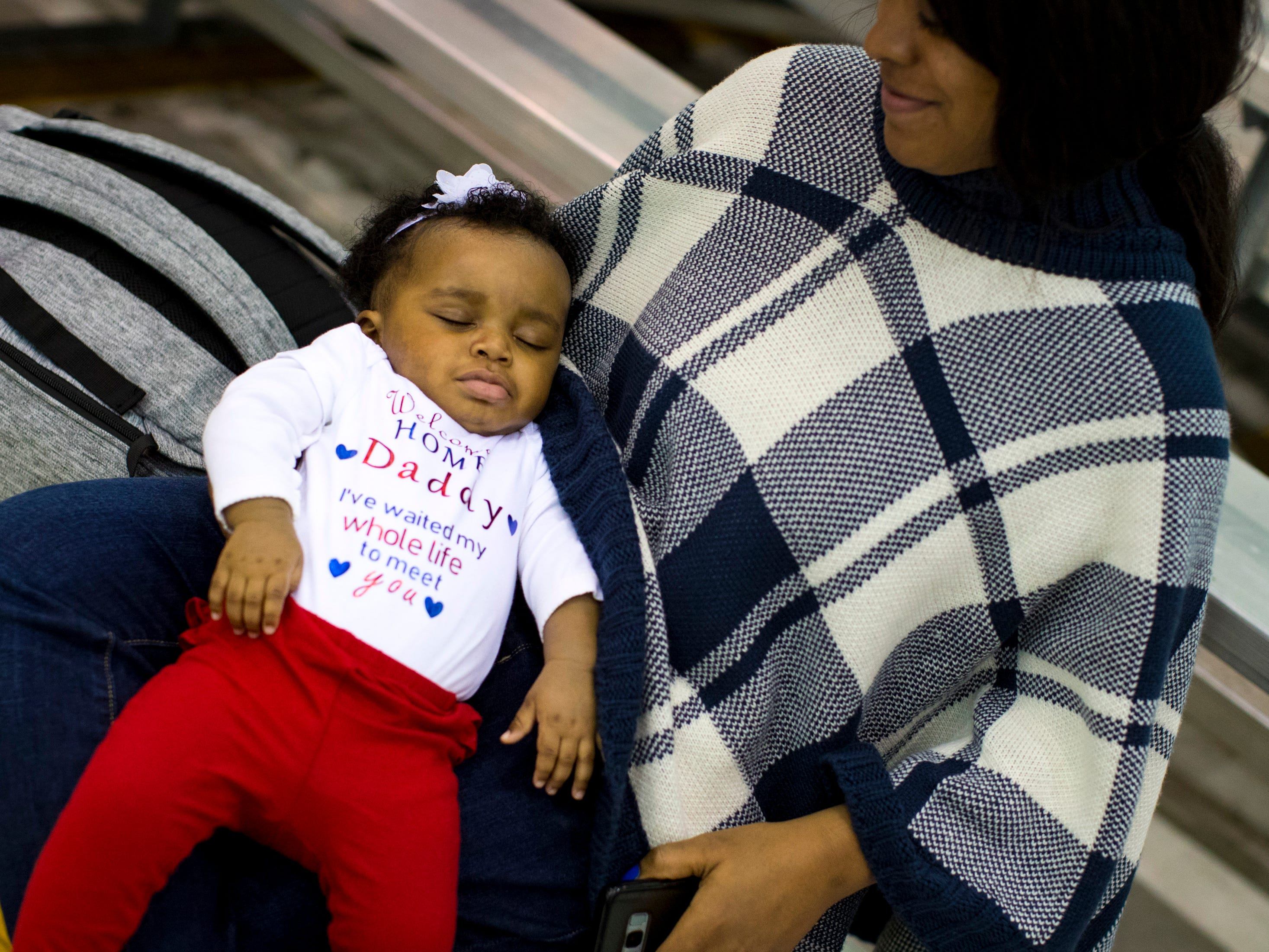 Aleighsia Hollis, 7 months, takes a nap while waiting for her father, Staff Sgt. Wayne Hollis, to arrive during the welcome home ceremony for members of the 101st Combat Aviation Brigade at Fort Campbell in Clarksville on Tuesday, Feb. 5, 2019. The soldiers were returning from a nine-month deployment to Afghanistan.