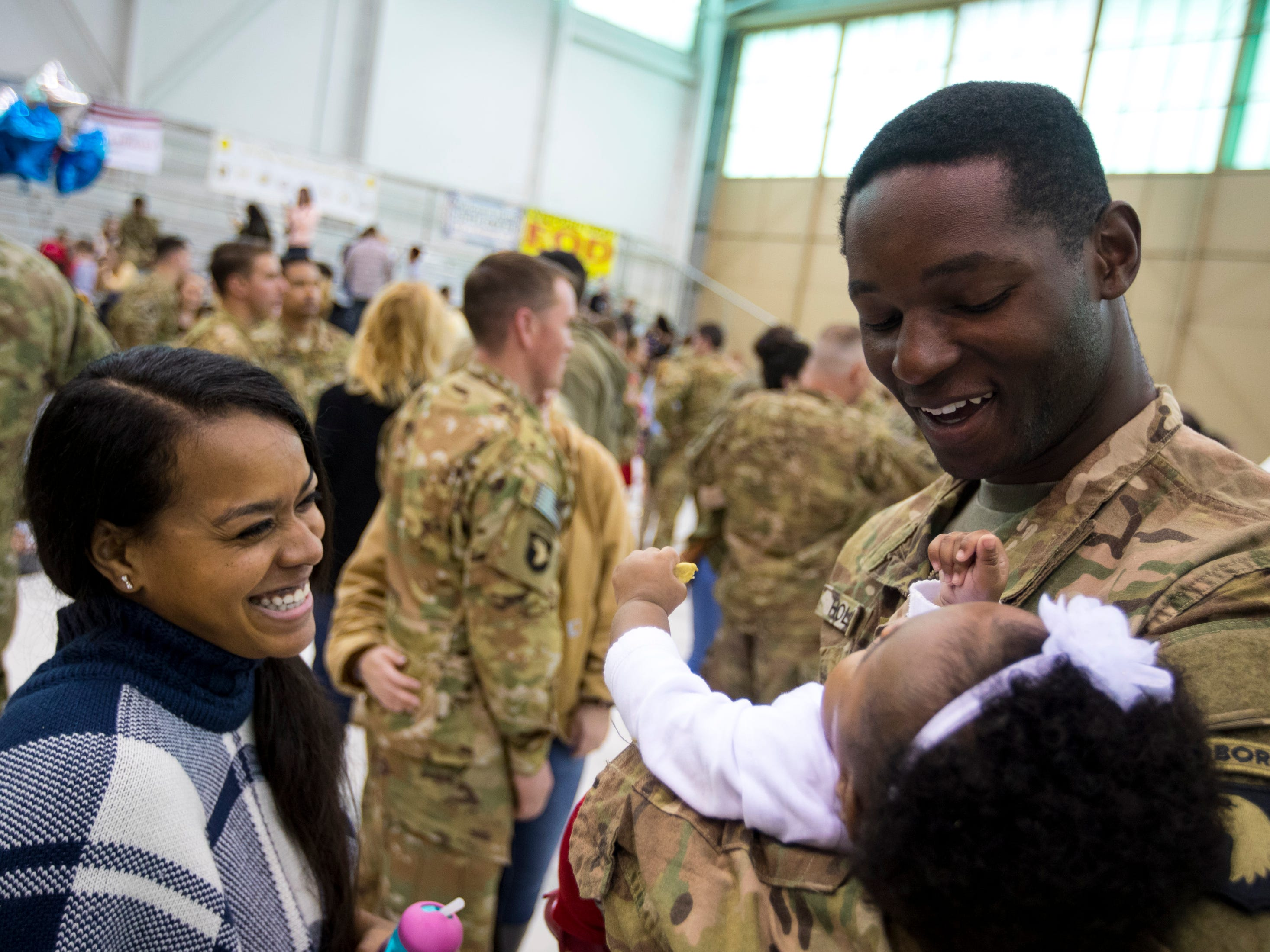 Wayne Hollis holds his daughter Aleighsia Hollis, 7 months, for the first time during the welcome home ceremony for members of the 101st Combat Aviation Brigade at Fort Campbell in Clarksville on Tuesday, Feb. 5, 2019. The soldiers were returning from a nine-month deployment to Afghanistan.