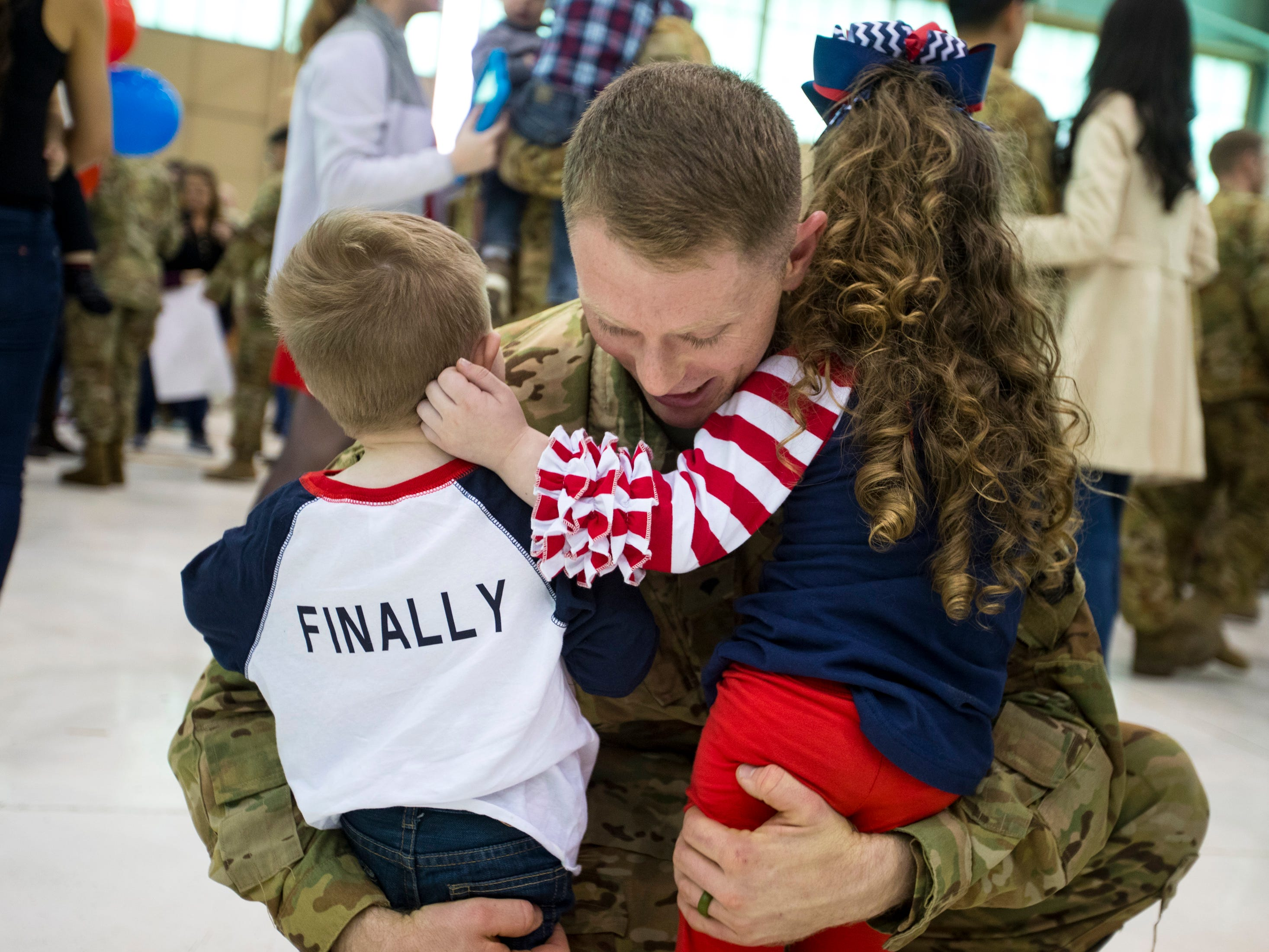 Specialist Travis Young hugs his children Dawson Young, 2, and McKenna Young, 4, during the welcome home ceremony for members of the 101st Combat Aviation Brigade at Fort Campbell in Clarksville on Tuesday, Feb. 5, 2019. The soldiers were returning from a nine-month deployment to Afghanistan.