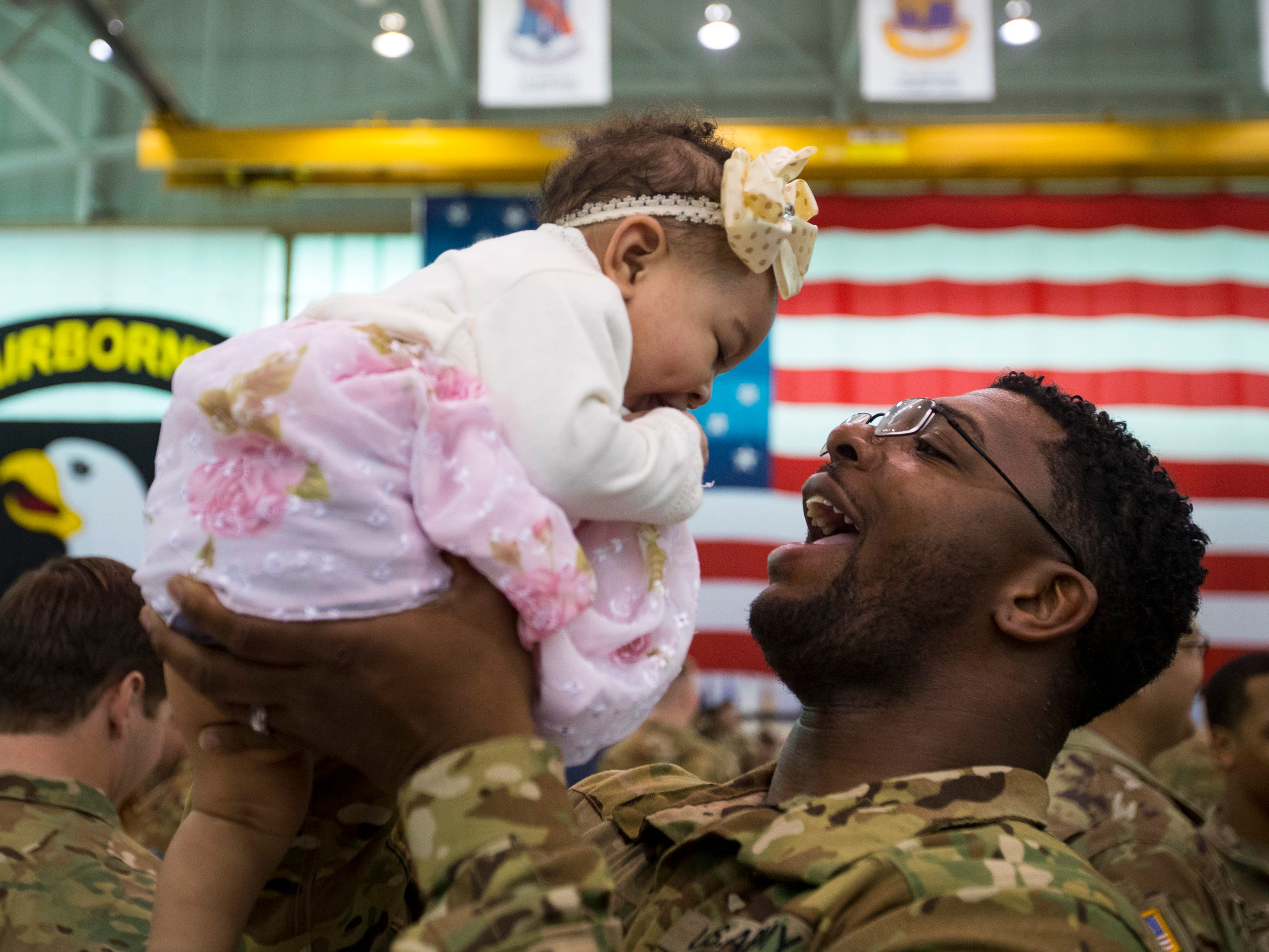 Armani Steele holds his daughter Aria Steele, 6 months, during the welcome home ceremony for members of the 101st Combat Aviation Brigade at Fort Campbell in Clarksville on Tuesday, Feb. 5, 2019. The soldiers were returning from a nine-month deployment to Afghanistan.