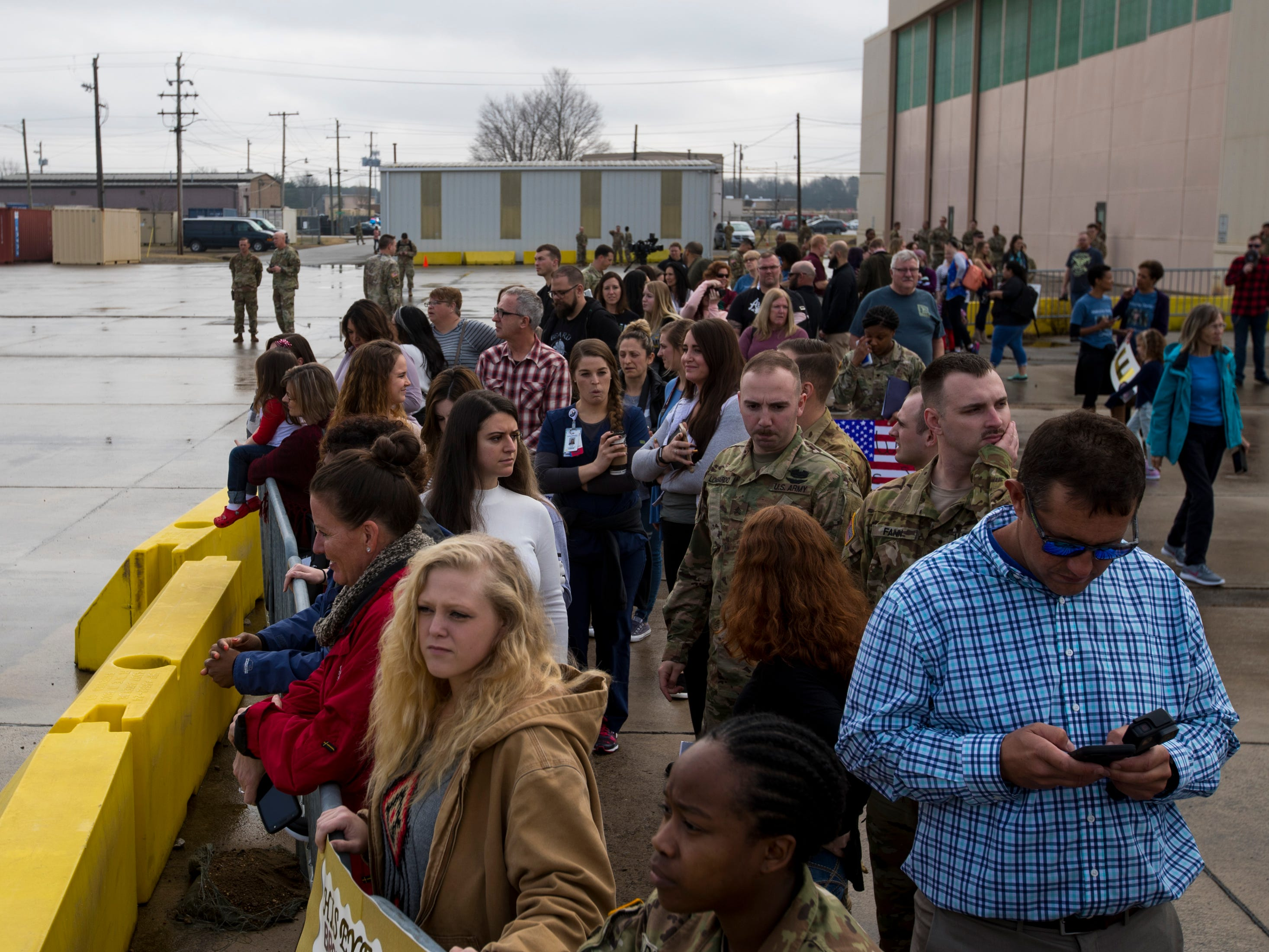 Friends and family members wait for the soldiers to arrive during the welcome home ceremony for members of the 101st Combat Aviation Brigade at Fort Campbell in Clarksville on Tuesday, Feb. 5, 2019. The soldiers were returning from a nine-month deployment to Afghanistan.