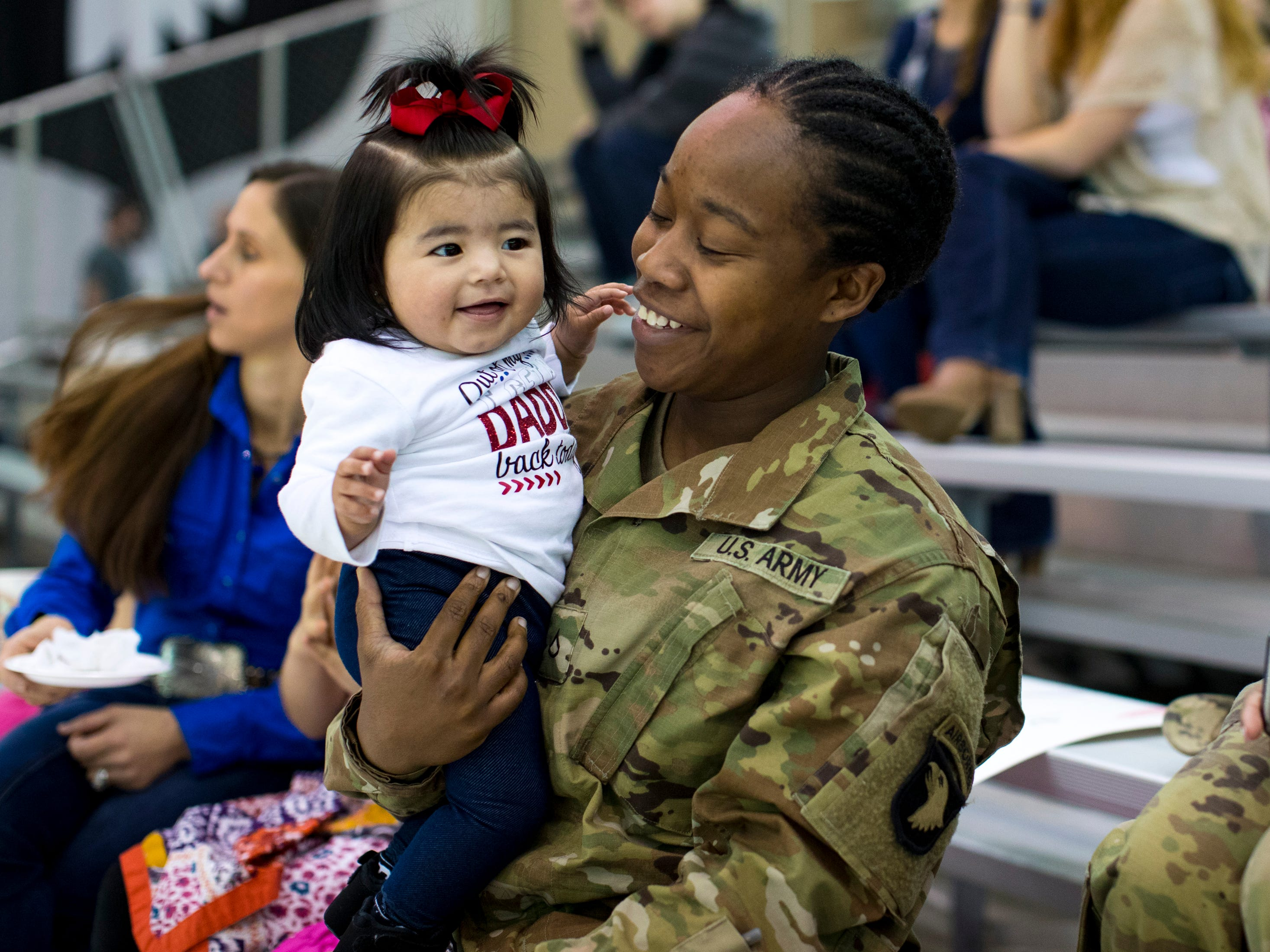 Private First Class Taneka Daniels holds Eliana Barajas, 8 months, during the welcome home ceremony for members of the 101st Combat Aviation Brigade at Fort Campbell in Clarksville on Tuesday, Feb. 5, 2019. The soldiers were returning from a nine-month deployment to Afghanistan.