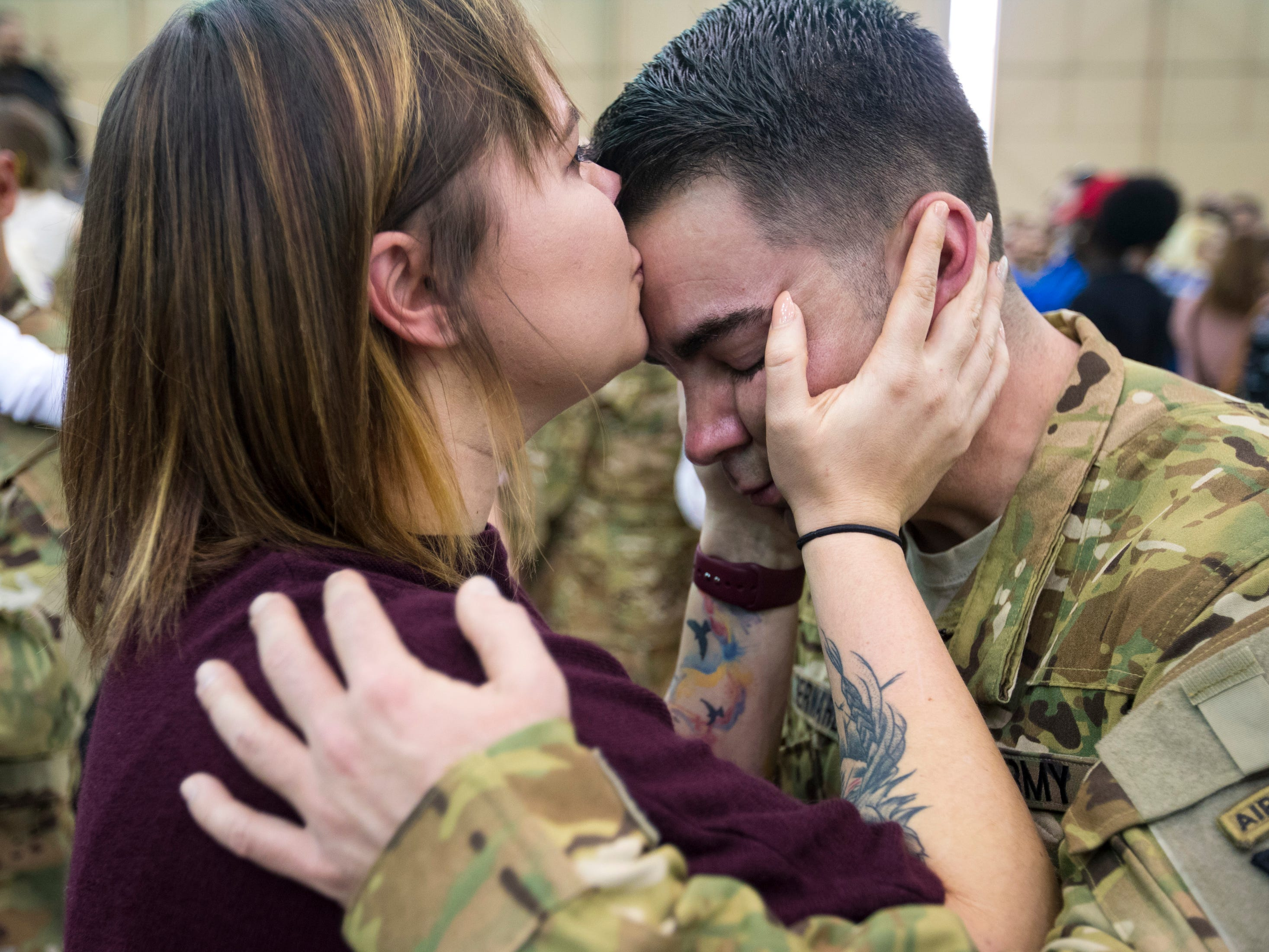 Staff Sgt. Nick Bernardy gets a kiss from Samantha Bernardy during the welcome home ceremony for members of the 101st Combat Aviation Brigade at Fort Campbell in Clarksville on Tuesday, Feb. 5, 2019. The soldiers were returning from a nine-month deployment to Afghanistan.