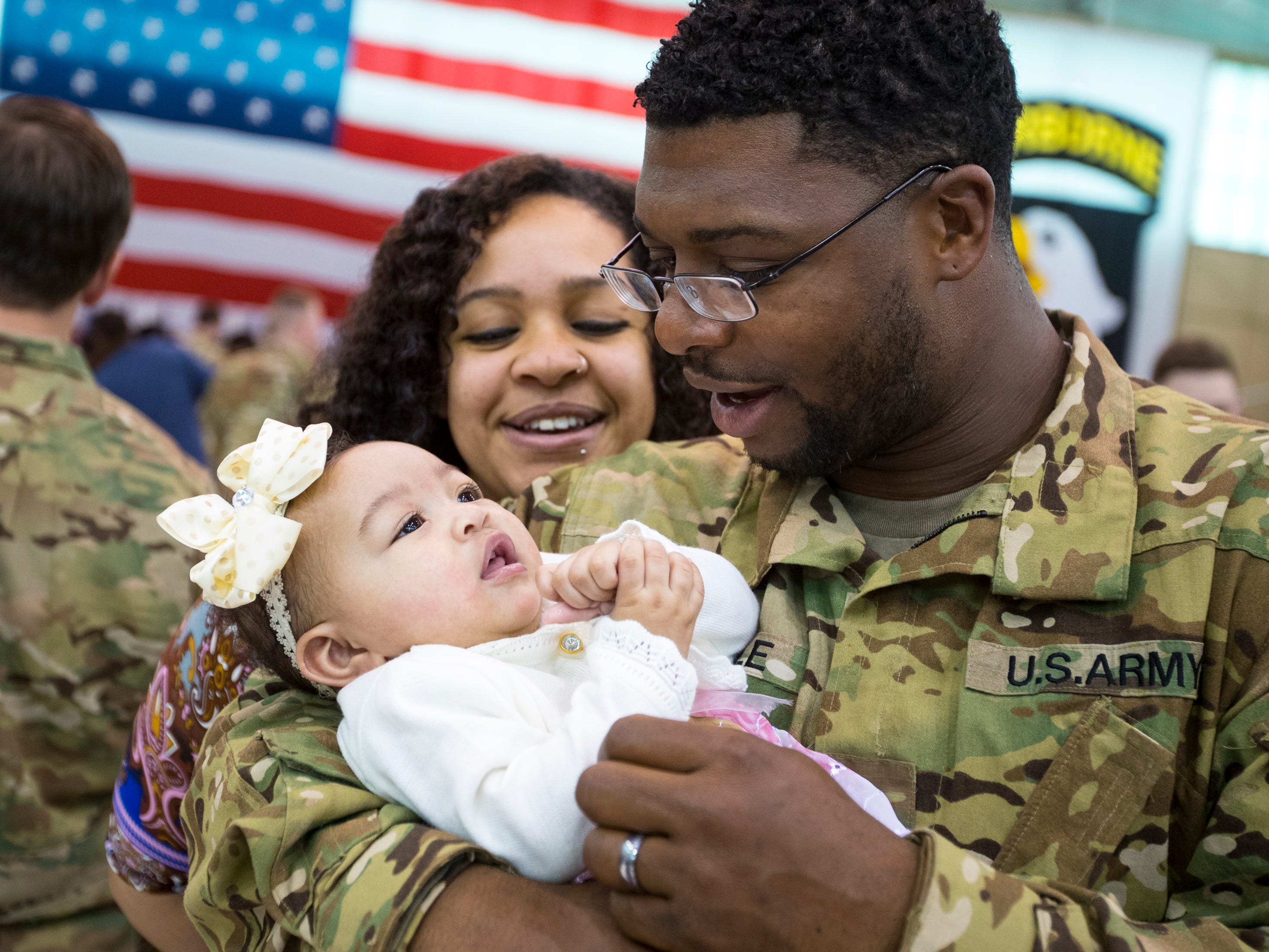 Armani Steele holds his daughter Aria Steele, 6 months, as his wife Jasmine watches during the welcome home ceremony for members of the 101st Combat Aviation Brigade at Fort Campbell in Clarksville on Tuesday, Feb. 5, 2019. The soldiers were returning from a nine-month deployment to Afghanistan.