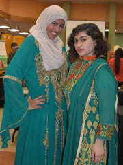 RVCC students Sarah Mohamed, left, and Humaira Mansuri at the College's Muslim Student Association Art Show.