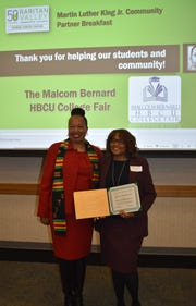 Richeleen Dashield, RVCC Dean of Multicultural Affairs, left, and Barbara Bernard, Executive Director of the Malcolm Bernard Foundation, at the Martin Luther King, Jr. Community Partner Breakfast.