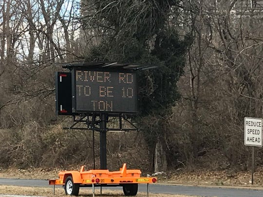 A sign on River Road in Piscataway alerts truckers to upcoming weight limit on roadway.