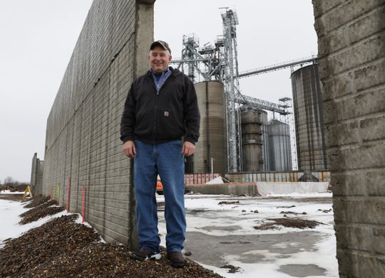 Ron Warnock,operations manager of Coshocton Grain, stands in the doorway of what will be the company's new soybean processing facility.
