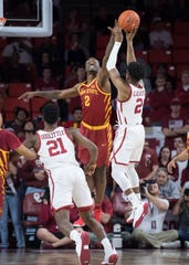 Oklahoma Sooners guard Aaron Calixte (2) shoots the ball over Iowa State Cyclones forward Cameron Lard (2) during the first half at Lloyd Noble Center.